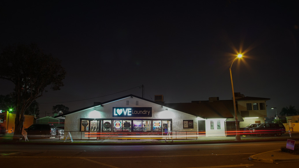 Love Laundry Long Beach storefront at night time